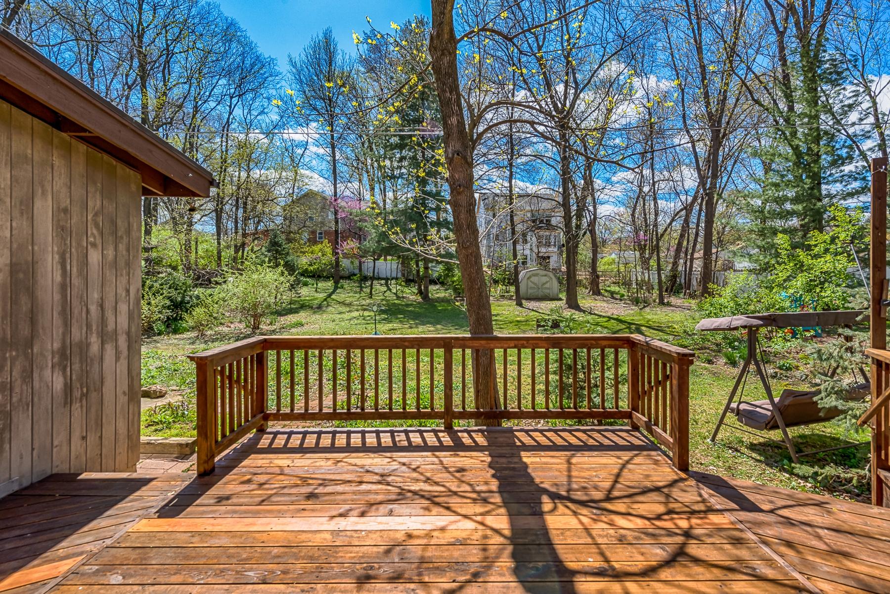 Deck facing large back yard